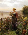 woman in a garden by daniel ridgway knight painting