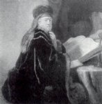 a scholar seated at a desk by rembrandt van rijn painting